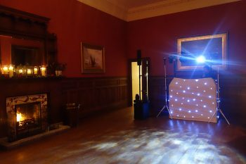 Boconnoc's Function Room with DJ Set Up and Fire Lit