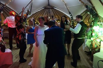Bride with Friends on the Dancefloor inside the Yurt at Gwel an Mor