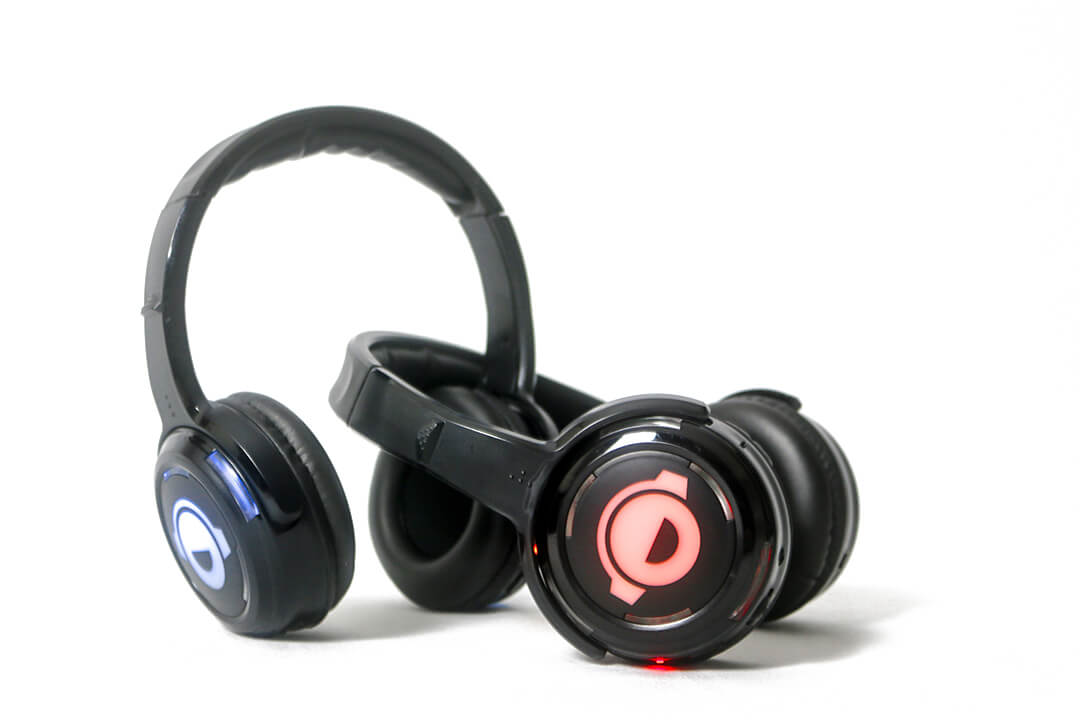 Silent Disco Headphones Lit Up with Plain Background